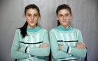 Twins Almedina (L) and Ajla Djulic pose for a portrait in a primary school in Buzim April 10, 2015. Reuters
