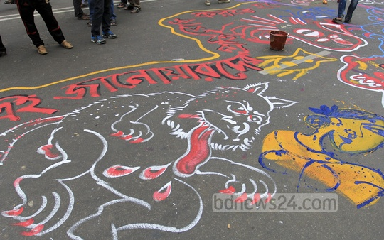 Dhaka University fine arts students busy with street painting as a part of their protest against police failure to prevent sexual harassment of a number of women during the Pahela Baishakh celebrations. Photo: asif mahmud ove/ bdnews24.com
