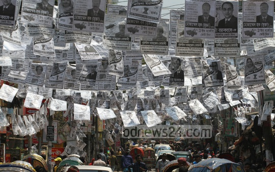 Posters shroud Gopibag area in Dhaka ahead of the much-hyped Apr 28 city corporation elections. Photo: nayan kumar/ bdnews24.com