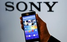 01. An employee poses with Sony's new Xperia Z4 smartphone after a news conference in Tokyo April 20. Reuters