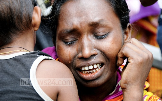 A woman breaks down in tears remembering her loved ones at the Rana Plaza collapse site on the second anniversary of the disaster on Friday. Photo: bdnews24.com