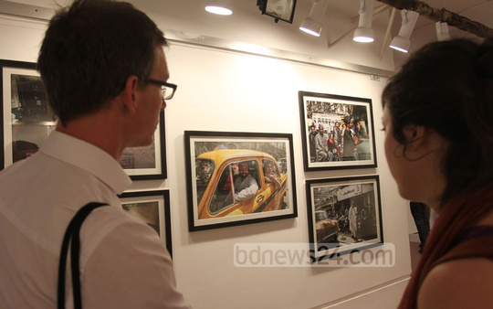 Visitors look around a photography exhibition titled 'From Kabul to Kolkata: of Belonging, Memories and Identity' at the Drik Gallery in Dhaka on Friday. Photo: tanvir ahammed/ bdnews24.com