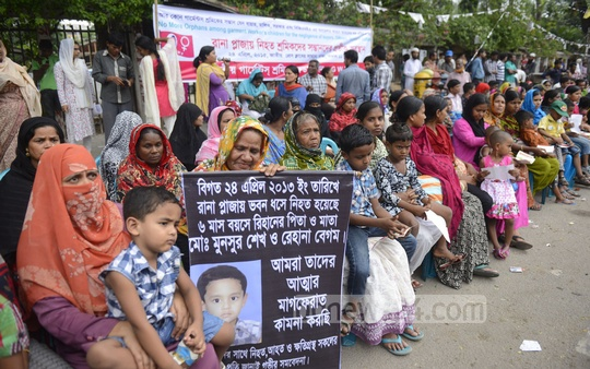 Children of Rana Plaza victims stage a sit-in demonstration in front of the National Press Club on Friday marking the second anniversary of the disaster that claimed over 1,100 lives. Photo: asif mahmud ove/ bdnews24.com