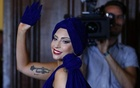 Lady Gaga leaves after a news conference in Brussels Sept 22, 2014. Reuters