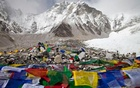 Everest base camp, with Buddhist prayer flags in the foreground. Police officials said the group was 25-strong and only three had so far been rescued from the mountain.  Reuters