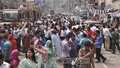 People stream out of buildings onto the streets in Motijheel after a tremor hit Dhaka on Sunday, a day after a 7.8 magnitude earthquake ravaged Nepal killing thousands.
