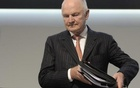 Ferdinand Piech, chairman of the board of German carmaker Volkswagen, carries his documents as he arrives at the 51th annual shareholders meeting in Hamburg on May 3, 2011
