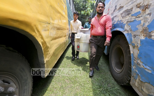 Polls logistics being taken to voting centres on Monday. Photo: asaduzzaman pramanik