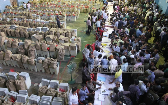 Presiding officers gather at MA Aziz Stadium in Chittagong on Monday to receive polls logistics. Photo: suman babu