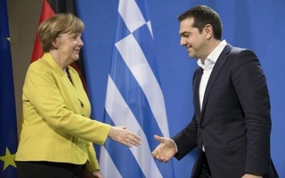 German Chancellor Angela Merkel and Greek Prime Minister Alexis Tsipras go to shake hands after addressing a news conference at the Chancellery in Berlin March 23, 2015. Reuters