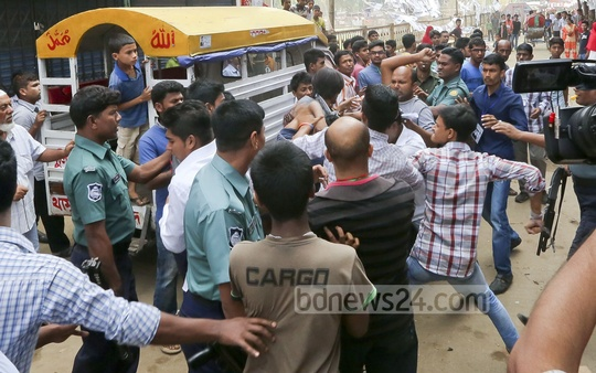 Two councilor aspirants seen fighting outside Tejgaon Model School during Tuesday's city polls.