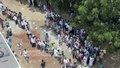 Voters queue up at the Banani's Jamiya Mohammadiya Islamia Kuril T&T Colony Madrasa on Tuesday to cast their votes in the city polls.