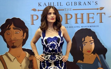 Movie star Salma Hayek poses in front of a billboard for her movie ''The Prophet'' in Beirut, Lebanon April 27, 2015. Reuters