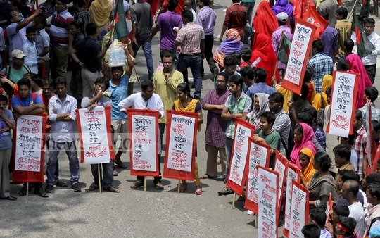Several workers' organisations gather with placards in front of the National Press Club on the international Labour Day on Friday.