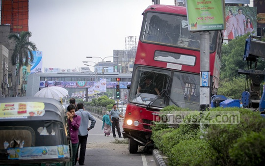A double-decker BRTC bus ran into a road divider at Bijoy Sarani in Dhaka on Friday.