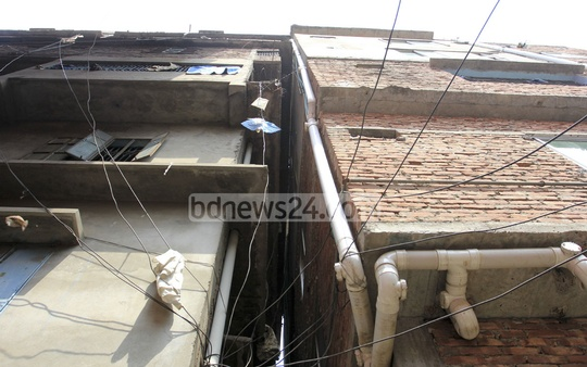 A seven-storey building tilted at Jatrabarhi's Dhalpur Lichubagan on Friday.