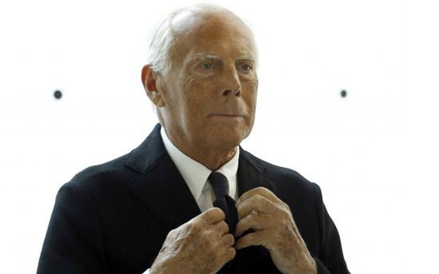 Italian designer Giorgio Armani poses during a photo call before his fashion show to celebrate the 40th anniversary of his career. Reuters