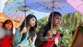 Women holding colourful Umbrella during the rally to mark Buddha Purnima on Sunday.