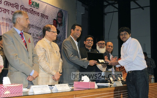 Prime minister's ICT adviser Sajeeb Ahmed Wazed Joy distributes laptops to university students at Bangladesh Computer Council on Sunday.