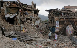 Earthquake victims walk on the rubble of collapsed houses in Sankhu, on the outskirts of Kathmandu, May 2, 2015. Reuters