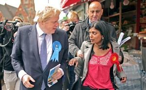 A Tory activist grabs Labour candidate Rupa Huq. Photo taken from Twitter feed of @SelsdonChapman