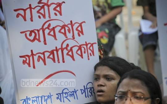 A woman activist holds a placard at a protest rally in front of the National Museum in Dhaka on Wednesday demanding justice for sexual assault on women during the Bengali New Year celebration. Photo: tanvir ahammed