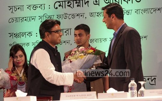 Prime Minister's ICT Adviser Sajeeb Wazed Joy congratulates newly elected mayor of Dhaka South City Corporation Sayeed Khokon at a seminar organised by Suchinta Foundation at Bangabandhu International Conference Centre (BICC) on Wednesday. Photo: nayan kumar