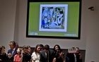 A Christie's employee holds up the winning paddle number for Pablo Picasso's 'Les femmes d'Alger (Version 'O')' (Women of Algiers) at Christie's Auction House in the Manhattan borough New York May 11, 2015. Reuters