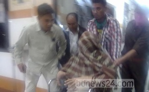 Salahuddin Ahmed being carried away face covered from one hospital to another in India