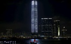 A tourist junk sails past the 118-storey-high skyscaper International Commerce Centre (ICC), the highest building in Hong Kong, during an audio-visual show