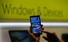 A Microsoft representative shows a smartphone with Windows 10 operating system at the CeBIT trade fair in Hanover in this file photo from March, 2015. REUTERS