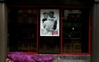 A homeless person sleeps rough under a poster in favour of same sex marriage on Dame Street, central Dublin as Ireland holds a referendum on gay marriage, May 22, 2015. REUTERS