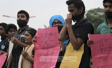 Several student organisations form a human chain on the Dhaka University campus on Saturday demanding punishment for those who gang-raped a Garo girl on a microbus.