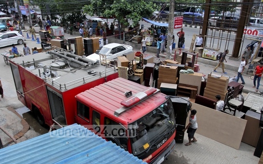 Furnitures moved out from shops after a fire in a shop at Dhaka's Panthapath on Sunday. Photo: tanvir ahammed