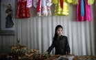 A woman stands in a gift shop in central Rason city, part of the special economic zone northeast of Pyongyang, in this August 30, 2011 file photo. REUTERS