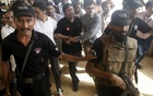 Police and Federal Investigation Agency (FIA) officials escort Shoaib Shaikh (C), CEO of Axact, a Pakistani software company, after he was produced before a district court in Karachi, Pakistan, May 27, 2015. Reuters