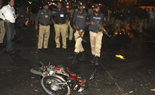 Police inspect the site of a blast that occurred during the cricket match between Pakistan and Zimbabwe, near Gaddafi Stadium in Lahore, Pakistan. Reuters