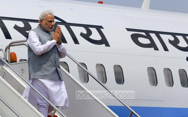 Narendra Modi greeted as he alights in Dhaka on two-day maiden state visit to Bangladesh. Photo: mustafiz mamun