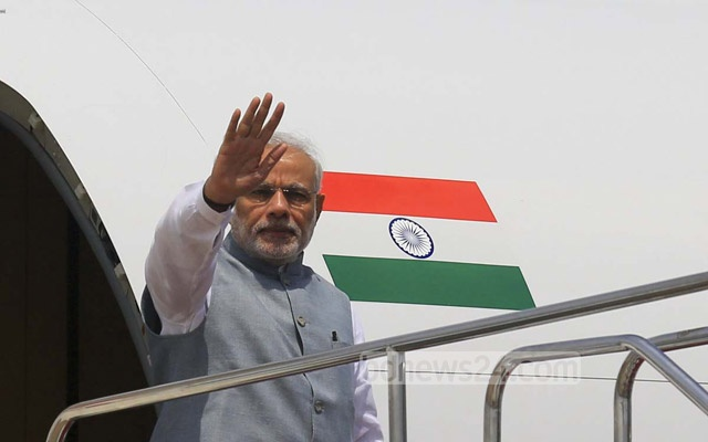 Indian Prime Minister Narendra Modi waving while getting off the Indian Air Force aircraft at Dhaka on Saturday. Photo: mustafiz mamun