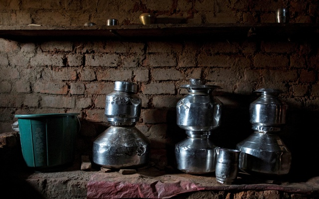 Metal pitchers used for storing water are seen in a room in Sakharam Bhagat's house in Denganmal village, Maharashtra, India. REUTERS