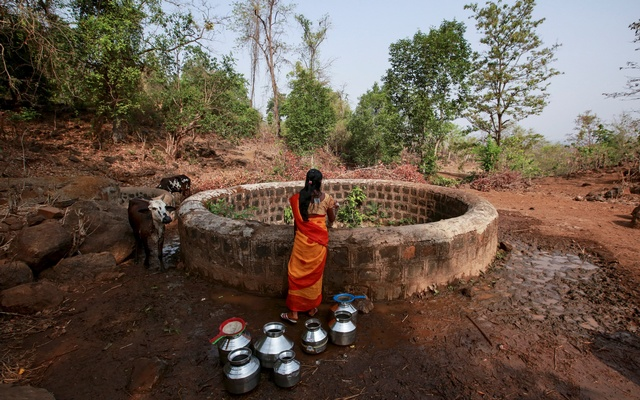 A resident fetches water from a well outside Denganmal village, Maharashtra, India, April 21, 2015. Reuters