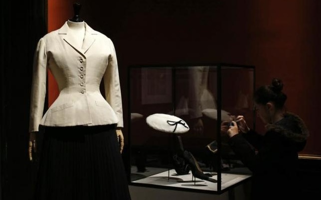A vintage dress by designer Christian Dior is presented in the exhibition 'Les Annees 50, La mode en France' (The 50s. Fashion in France, 1947-1957) at the Palais Galliera fashion museum in Paris, July 10, 2014. Reuters