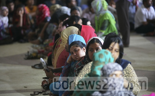 Eid holidaymakers queue up at Kamalapur Railway Station in Dhaka to secure advance tickets on Thursday.