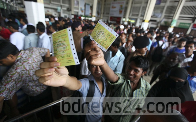 Going home for Eid, these men managed advance train tickets at Kamalapur Railway station on Thursday.