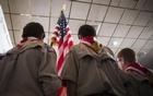 Boy Scouts stand on stage with a US flag during the Pledge of Allegiance to begin the inaugural Freedom Summit meeting for conservative speakers in Manchester, New Hampshire April 12, 2014. Reuters