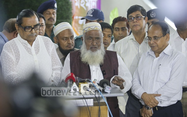 Secretary Chowdhury Md Babul Hassan (extreme right) standing beside Religious Affairs Minister Matior Rahaman at a press meet on Aug 16. File Photo