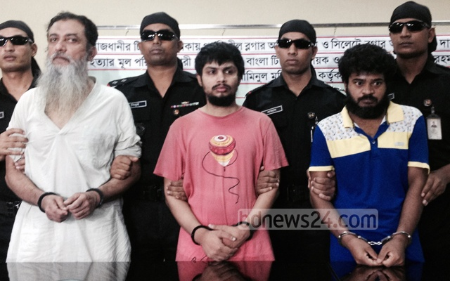 Touhidur Rahman, first from left, a British citizen of Bangladeshi origin, was held with two others on charges of masterminding murders of secular bloggers Avijit Roy and Ananta Bijoy Das.