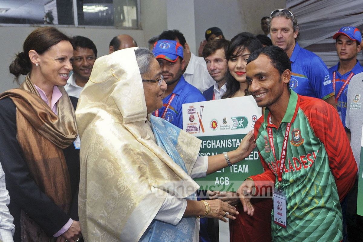 Prime Minister Sheikh Hasina extends her best wishes to Alam Khan, the skipper of the Bangladesh squad for the first-ever international disability cricket tournament, after inaugurating on Wednesday the five-team T20 meet hosted by the ICRC with the support of the Bangladesh government and cricket board. Photo: PMO