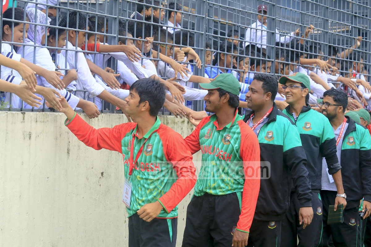 The opening match between Bangladesh and England of the first-ever international disability cricket tournament was cancelled due to rain on Wednesday. The home team spent the day exchanging greetings with the spectators in the gallery. Photo: mustafiz mamun