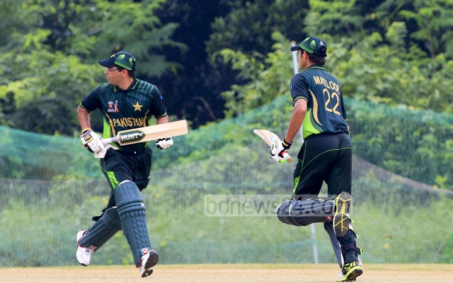 Pakistan batsmen take a run during their match against Bangladesh in the ICRC Twenty20 Cricket Tournament on Saturday. Photo: mustafiz mamun
